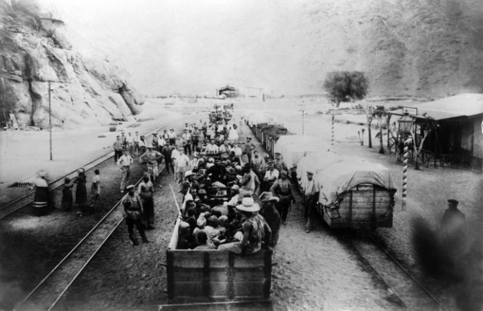 B&W photo of people in rail cars