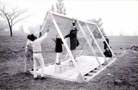 Group lifts wooden frame into place