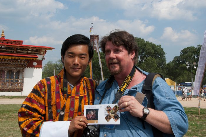 Tinsley poses for photo with young Tibetan man