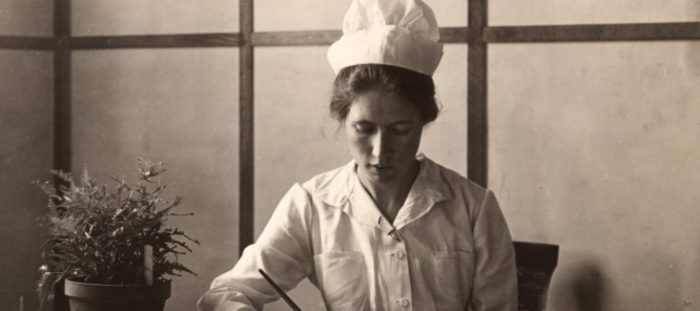 nurse writing at desk