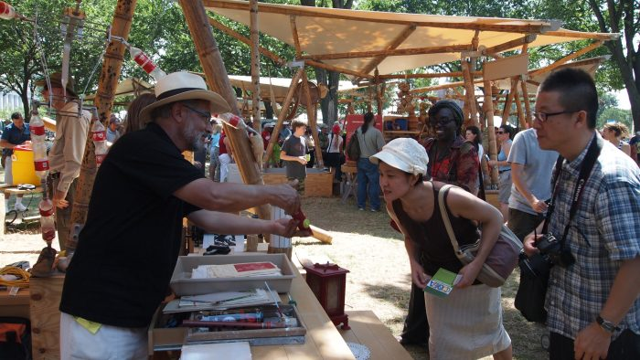 Artisan talking with visitors