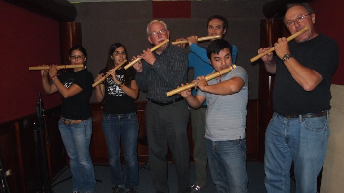 Group including Dan Sheehy playing flute