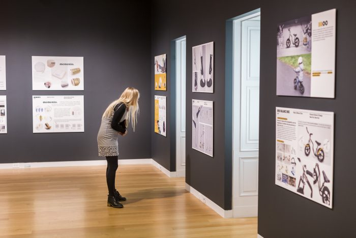 Girl in gallery looking at exhibits