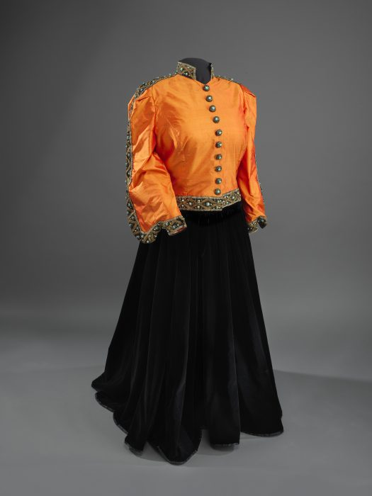 Black skirt with orange sill jacket