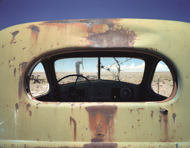 The cab of an abandoned International Harvester one-ton truck.