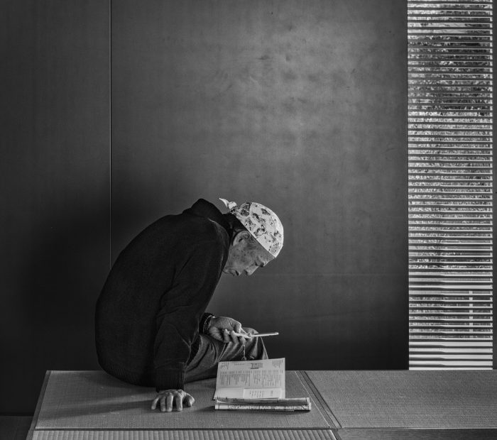 A visitor lost in thought at Tokyo's Suzuki Museum