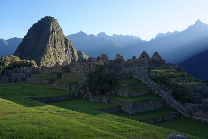 The sun rises over Machu Picchu.