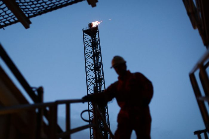 Silhouette of worker on oil rig