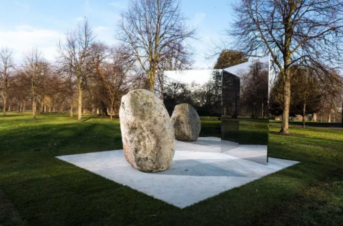 outdoor sculpture of stone and mirrors