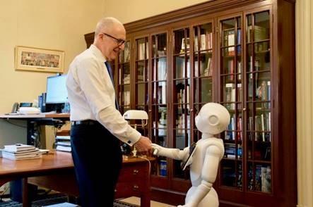 Skorton shakes hands with robot