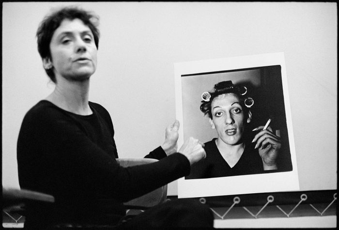 Diane Arbus holds large photo