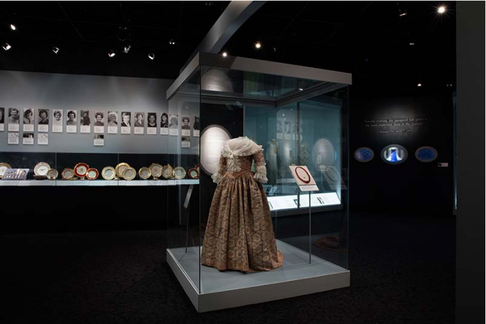 Gown in display case