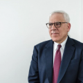 Rubenstein stands against white background