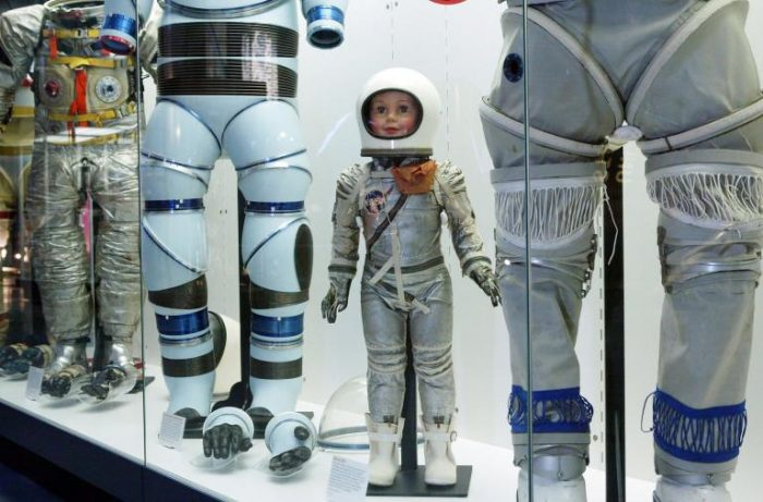Astronaut doll in display case