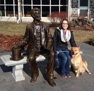 Hayes on bench with dog and Abraham Lincoln statue