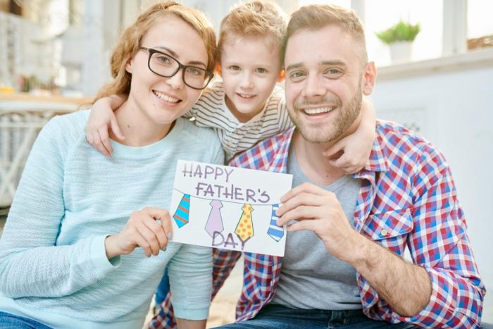 Stock footage of family with Father's Day Card