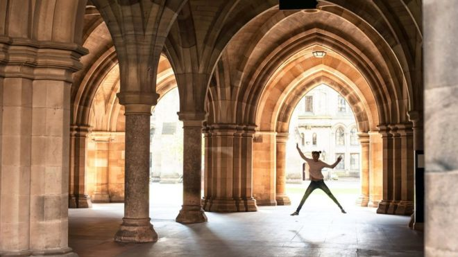 dancer under gothic arches