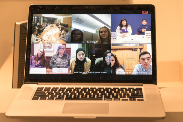 Photo of laptop screen showing videoconference participants.
