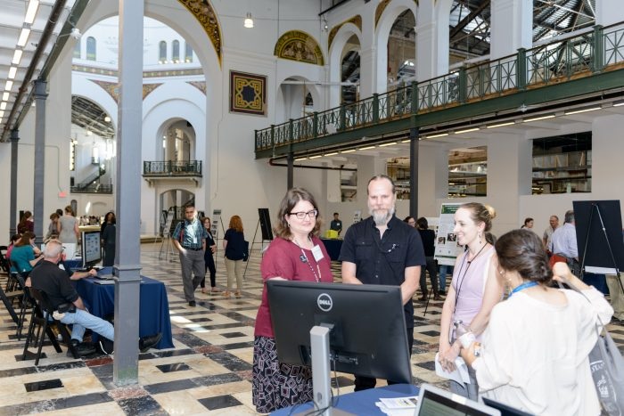 Visitors chat with presenters in Grand Hall