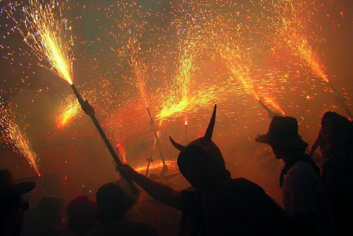 costumed people holding sparklers