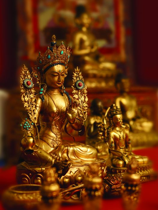 Gold statue of Buddha with jewels