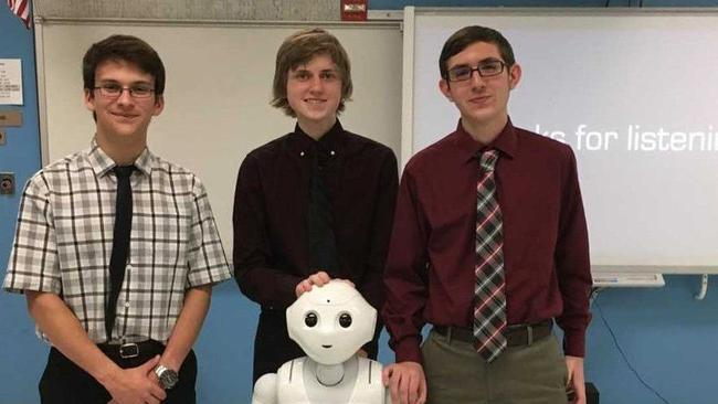 Students pose with Pepper robot
