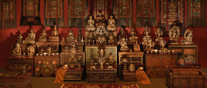 Shrine with several Buddhas on display