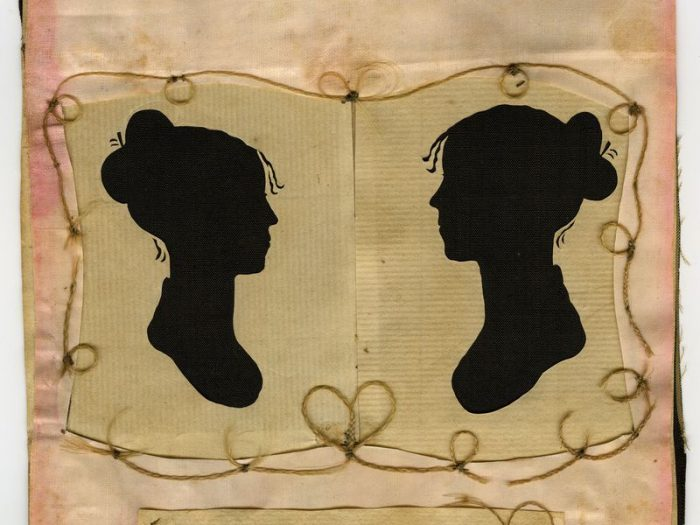 paper silhouettes of two women facing each other
