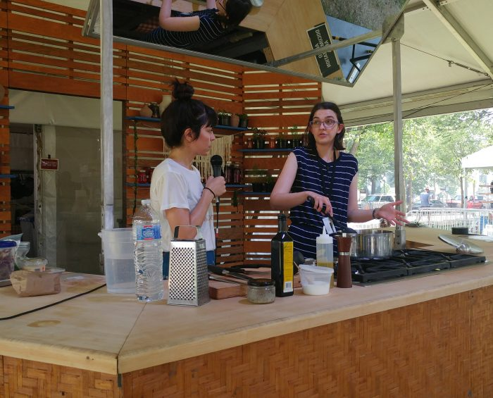Elmi at cooktop in Foodways tent