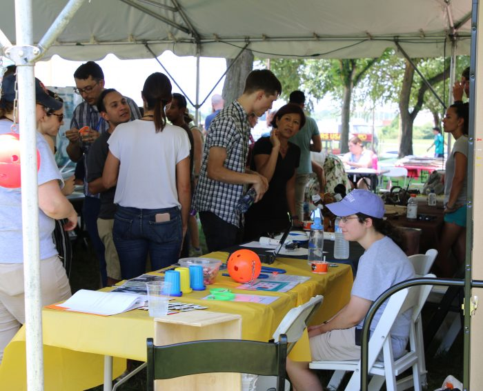 People visiting information tables