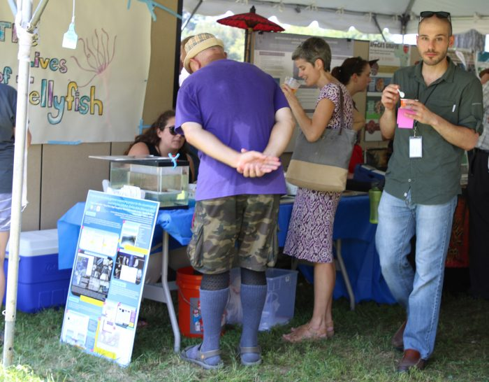 Group gathers around information table