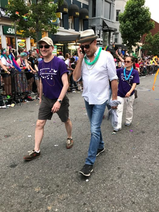 Davis and Heffner walk in Pride parade