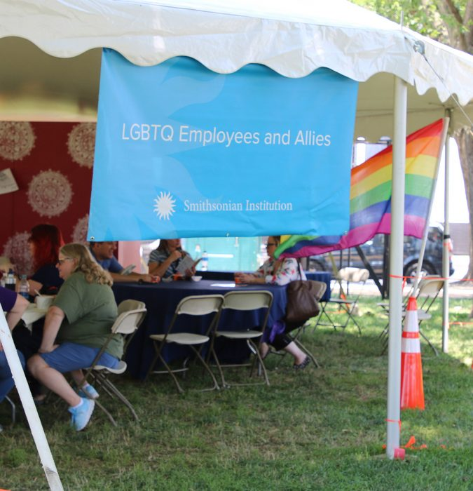 Tent with LGBTQ banner