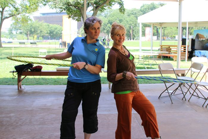 Two women with hula hoops