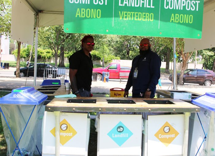 Two men manning recylcling booth