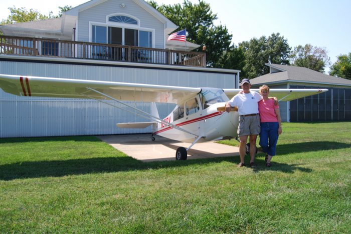 Mr and Mrs Massimini in front of their small plane