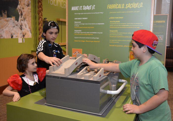 Children building a bridge at interactive station