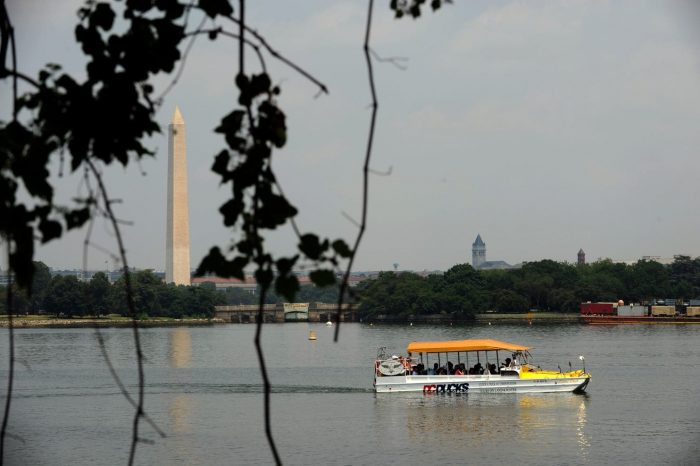 DC Duck boat on Tidal Basin with Washington Monument in background