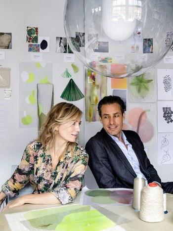 Designers pose in their studio