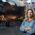 Ellen Stofan in front of space shuttle