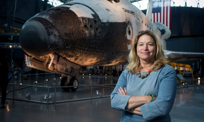 Ellen Stofan in front of space shuttle