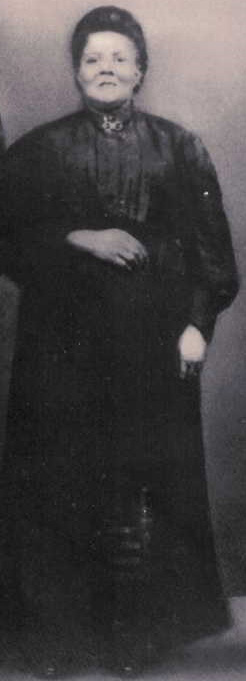 Photo of distinguished looking woman in black dress