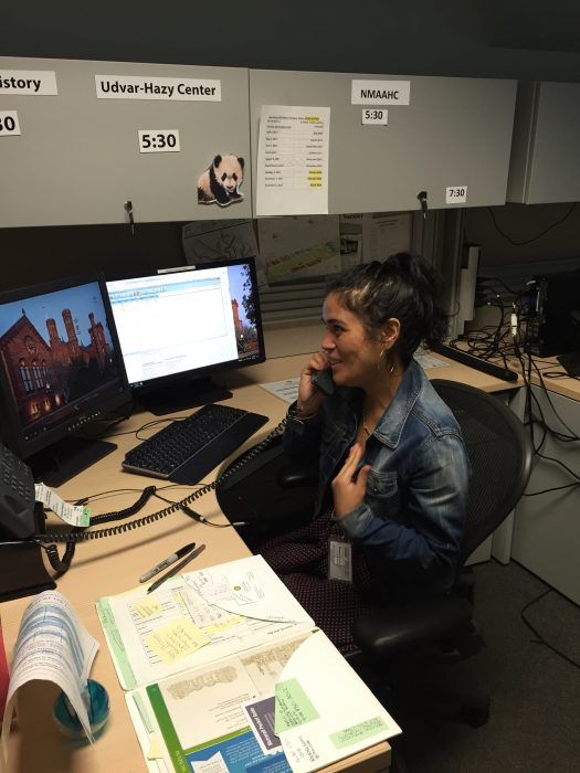 Woman in call center talking on phone
