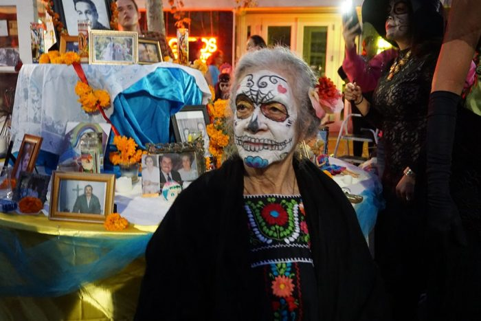 Older woman painted and dressed as Catrina for Day of the Dead