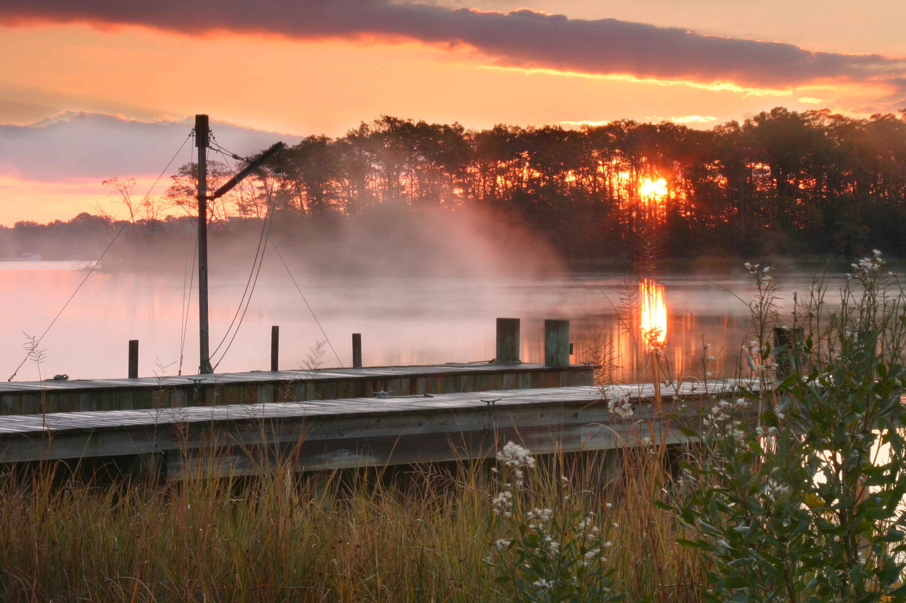 mist rising on river at sunrise