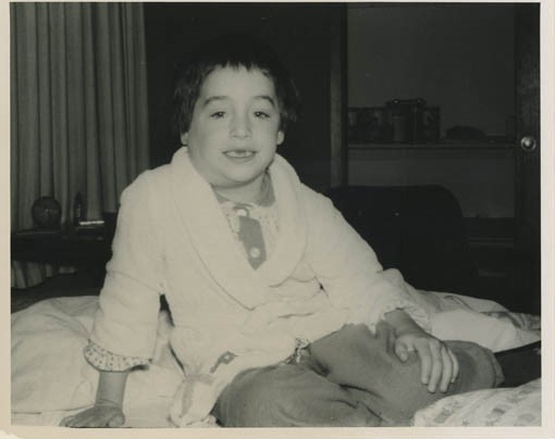 Black and white photo of child with mumps