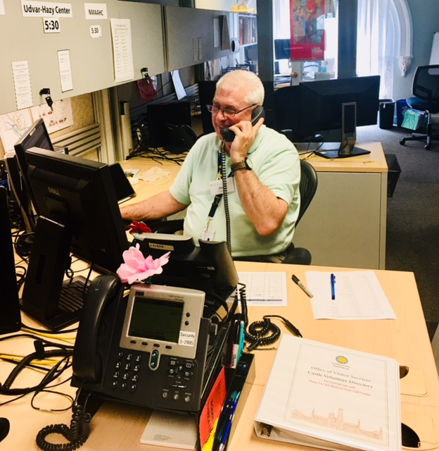 Volunteer Jim Peterson on the phone in the call center