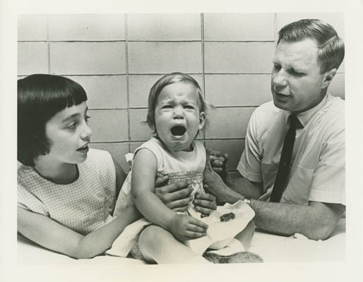 Black and white photo of crying child getting a vaccination