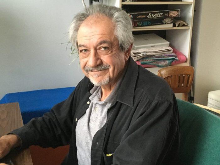 Older man smiles at camera