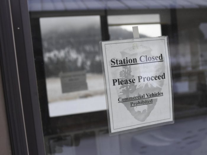 Black and white photo of closed sign on door